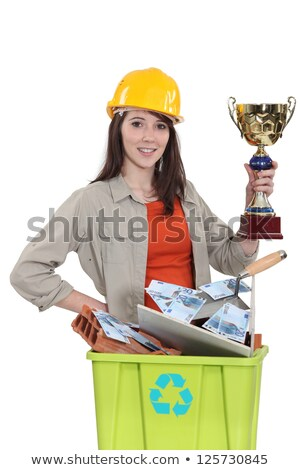 Female laborer holding gold cup Stock photo © photography33