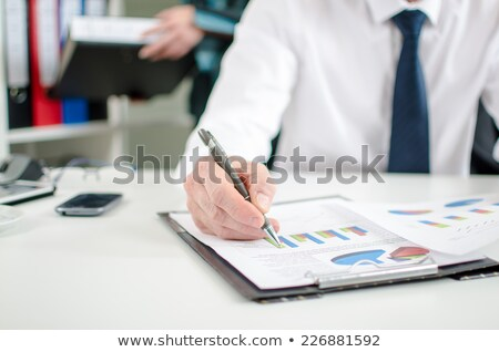 Worker checking report Stock photo © photography33
