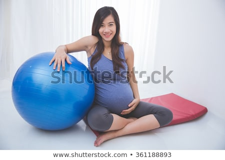 Fitness enthusiast holding a swiss ball Stock photo © stockyimages