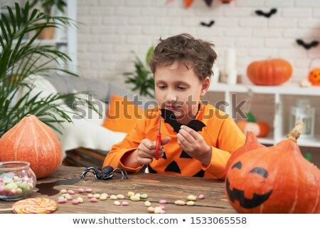 little boy dressed as devil and preparing decorations stock photo © photography33