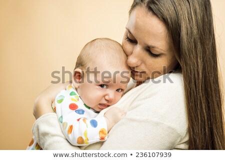 bebek · anneler · silah · kadın · kanepe · gülme - stok fotoğraf © andreypopov