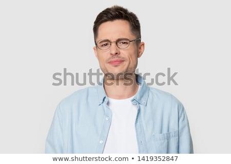 Suspicius man looking over eyeglasses Stock photo © photosebia