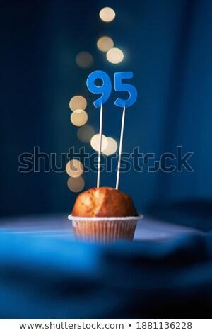Birthday cake with burning candle number 95 Stock photo © Zerbor