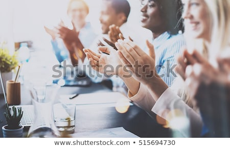 close up of business people clapping hands business seminar concept stock photo © deandrobot