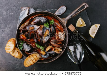 rustic black mussel in tomato sauce stock photo © zkruger