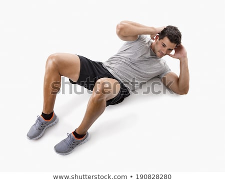 Happy muscular man doing abs exercise Stock photo © deandrobot