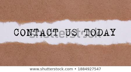 Call Now under paper Stock photo © fuzzbones0