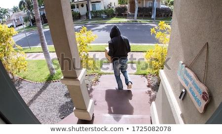 Ladrão homem tiro luz janela quarto de hotel Foto stock © jeancliclac