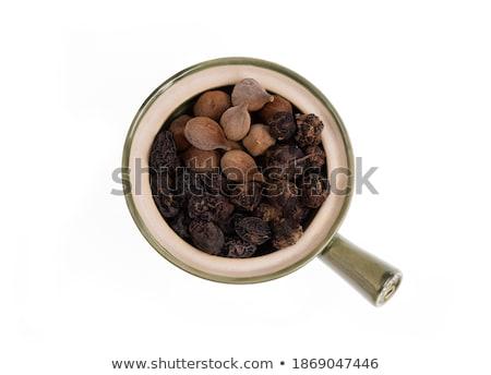 Organic Chebulic Myrobalan in ceramic bowl. Stock photo © ziprashantzi