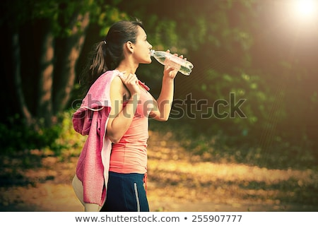 Fit woman with towel and water bottle Stock photo © wavebreak_media