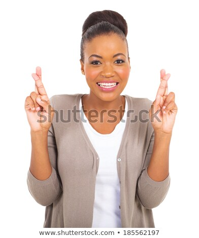 Close up pretty businesswoman with finger crossed  Stock photo © wavebreak_media