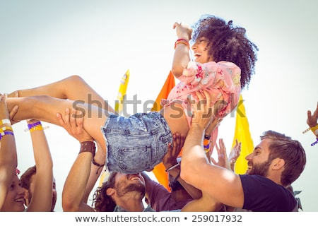 Happy hipster woman crowd surfing Stock photo © wavebreak_media