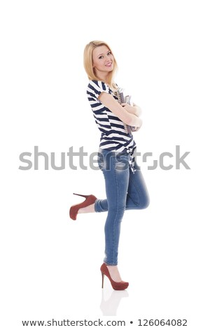 Belo feliz loiro menina inclinando-se para trás Foto stock © alexandrenunes