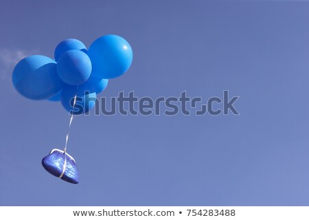 Blue purse flying with balloons Stock photo © IS2