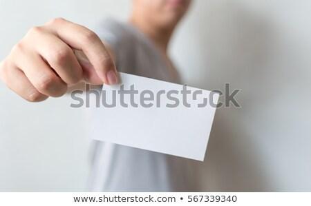 Casual man showing blank mock up credit card Stock photo © stevanovicigor