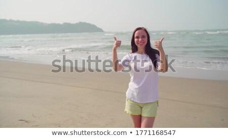 Charming laughing woman on shoreline Stock photo © dash