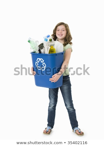 Young girl standing by recycling bin Stock photo © IS2