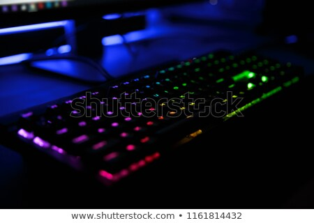 close up view of workplace with led rainbow backlight gaming key stock photo © deandrobot