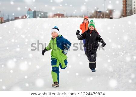 Little boy in winter clothes running Stock photo © colematt