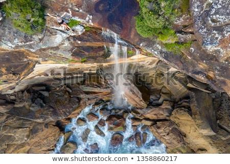 女性 · 岩 · 座って · 高い · ポルトガル · 水 - ストックフォト © lovleah
