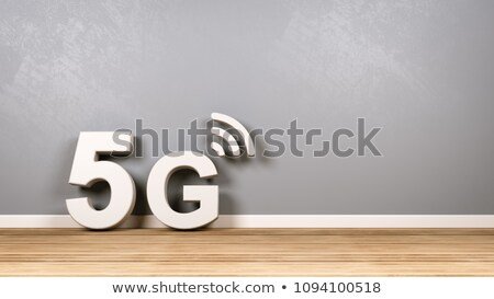 5G Text on Wooden Floor Against Wall Stock photo © make