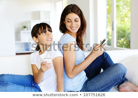 Mother And Daughter Using Mobilephone Stock photo © AndreyPopov