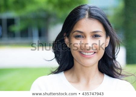 portrait of happy smiling indian woman outdoors Stock photo © dolgachov