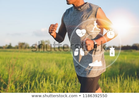 an athlete man with a smart watch stock photo © andreypopov