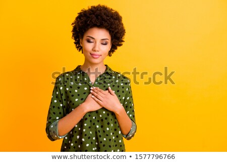 Happy brunette woman in casual clothes touching her hair Stock photo © deandrobot