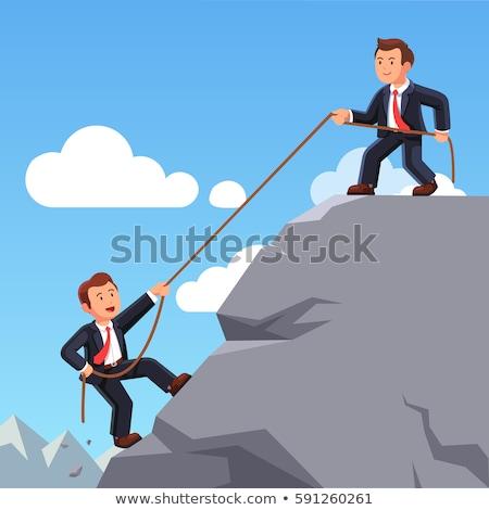 Businessman helping colleague with rope Stok fotoğraf © Elnur