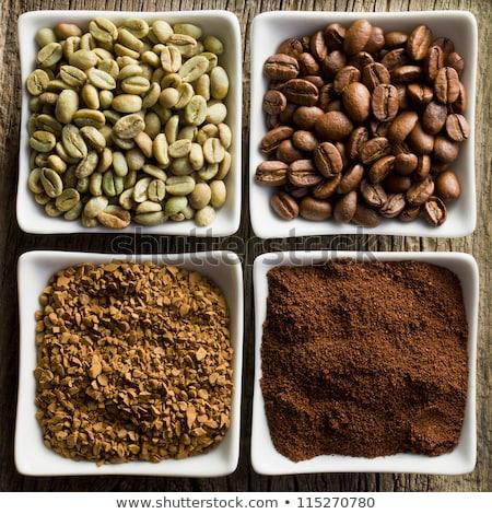 Fresche greggio chicchi di caffè terra polvere Foto d'archivio © DenisMArt