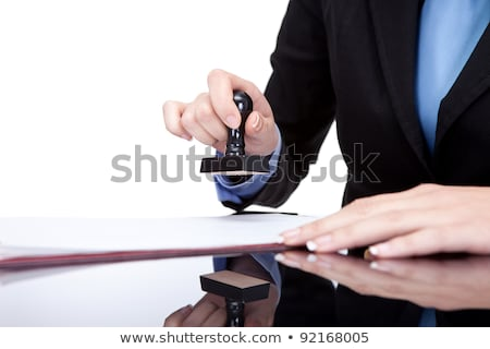 Female Hands Stamping Document In Office Stock photo © AndreyPopov