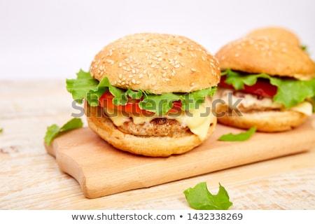 Carne burger tavolo in legno luce cibo di strada fast food Foto d'archivio © Illia