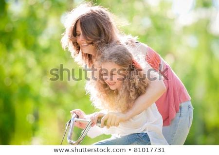велосипед · парка · лет · женщину · девушки - Сток-фото © lopolo