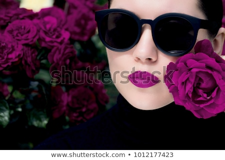Lips with flower. Close-up beautiful female lips with bright red lipgloss makeup. Perfect clean skin Stock photo © serdechny