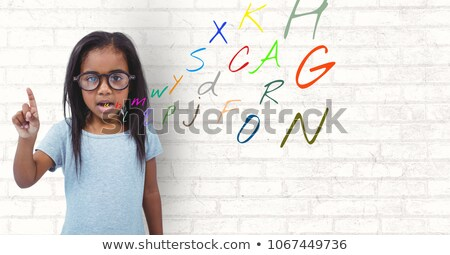 girl speaking with colour letters coming up from mouth Stock photo © wavebreak_media