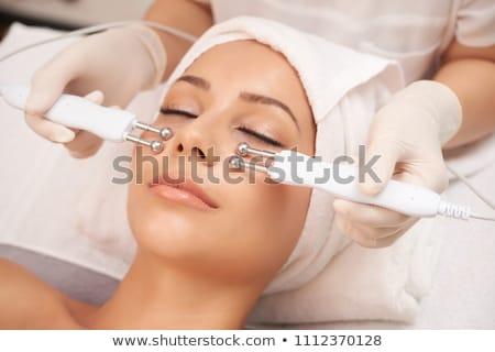 woman having hydradermie facial treatment in spa Stock photo © dolgachov