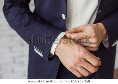 Elegant young fashion man dressing up for wedding celebration.  Stock photo © Illia