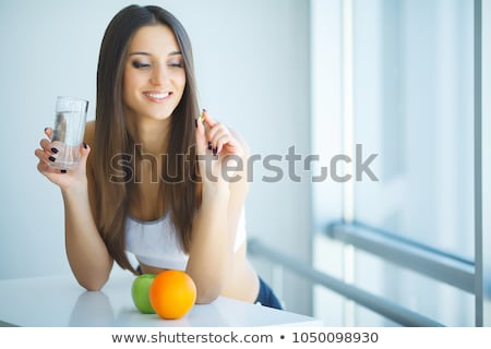 Colorful Pills in a Drinking Glass Stock photo © make