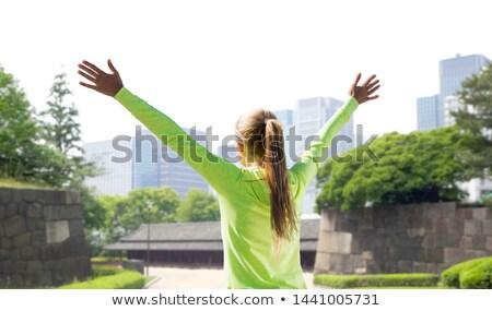Boldog nő sportok ruházat Tokió város Stock fotó © dolgachov