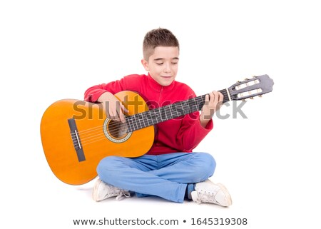 Little boy playing guitar Stock photo © lovleah