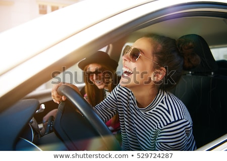 Fun smile by young woman wearing sunglasses stock photo © darrinhenry