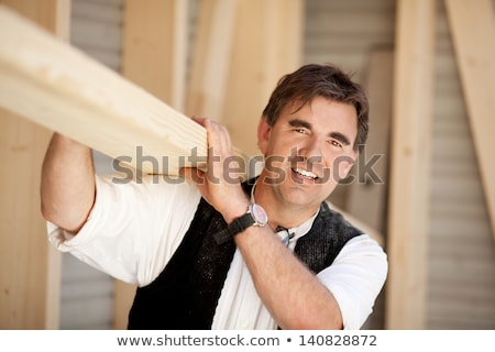 Smiling carpenter holding timber frame Stock photo © photography33