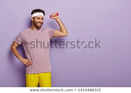 a man raising a dumbbell Stock photo © photography33
