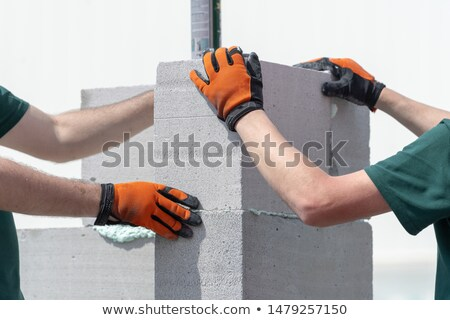 Worker holding concrete block Stock photo © photography33