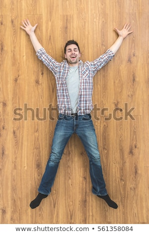 young man laying on floor and smiling stock photo © feedough