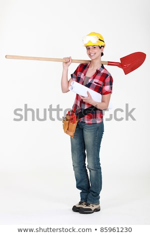 Female construction worker holding plans and spade Stock photo © photography33