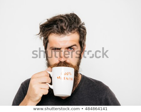 A serious man drinking a cup of coffee Stock photo © photography33