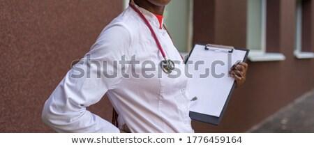 ejecutivo · carpeta · nota · pluma · negro · madera - foto stock © wavebreak_media