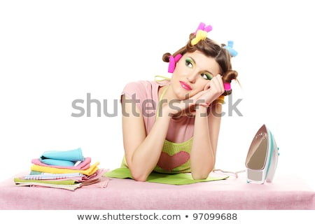 Housewife with iron and curler Stock photo © Massonforstock